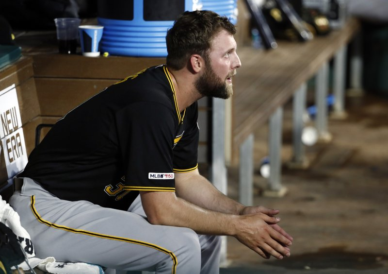 Pittsburgh Pirates starting pitcher Jordan Lyles sits in the dugout in the fourth inning of a baseball game against the Texas Rangers in Arlington, Texas, Tuesday, April 30, 2019. (AP Photo/Tony Gutierrez)