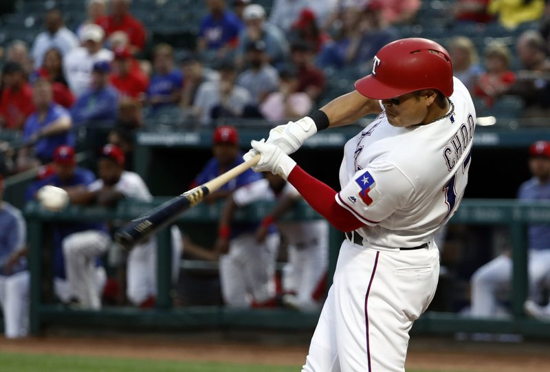 Texas Rangers' Shin-Soo Choo singles to center field off a pitch from Pittsburgh Pirates starting pitcher Jordan Lyles (31) in the first inning of a baseball game in Arlington, Texas, Tuesday, April 30, 2019. (AP Photo/Tony Gutierrez)