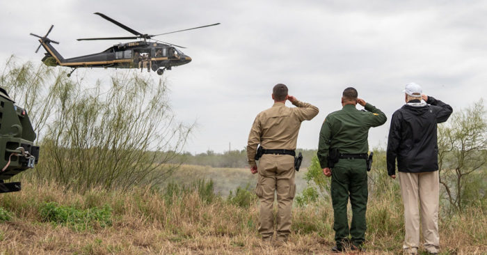 President Donald J. Trump salutes a passing U.S. Border Patrol helicopter during his walk along an overlook at the Rio Grande Thursday, January 10, 2019, near the U.S. Border Patrol McAllen Station in McAllen, Texas. (Official White House Photo by Shealah Craighead)
