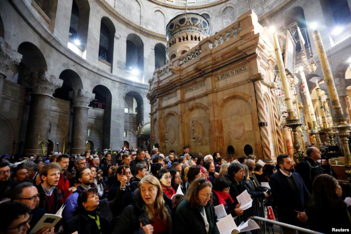 Christian worshipers attend Easter Sunday Mass in Jerusalem's Holy Sepulcher