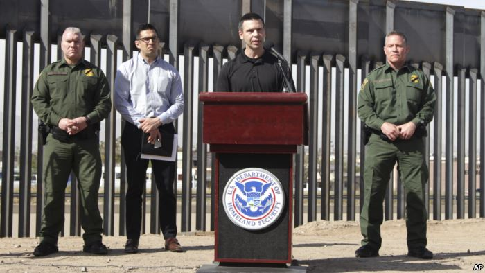 Customs and Border Protection Commissioner Kevin McAleenan (C) announced that