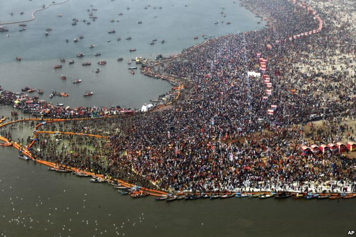 FILE - An Ariel view of thousands of Hindu devotees taking dips at Sangam, th