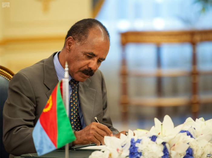 FILE - Eritrean President Isaias Afwerki signs a peace accord with Ethiopia i