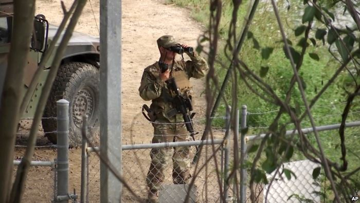 FILE - In this April 10, 2018, file frame from video, a National Guard troop