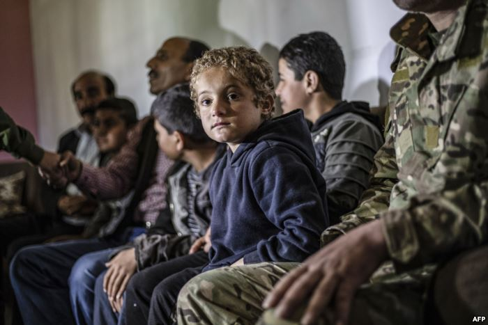 FILE - Iraqi Yazidi children rescued from the Islamic State (IS) group wait t