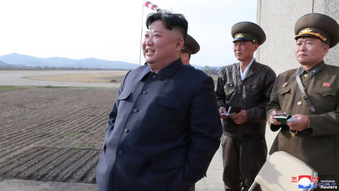 FILE - North Korean leader Kim Jong Un, accompanied by two military officials