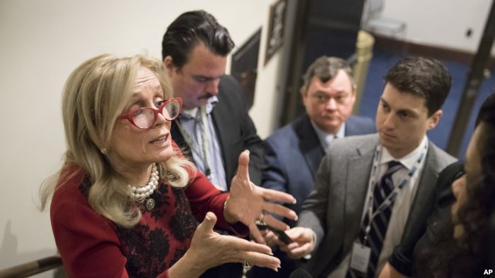 FILE - Rep. Debbie Dingell, D-Mich., talks to reporters in Washington, Nov. 2