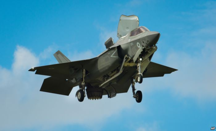 FILE - The F-35 Lightning II hovers in front of crowds at the Farnborough Air