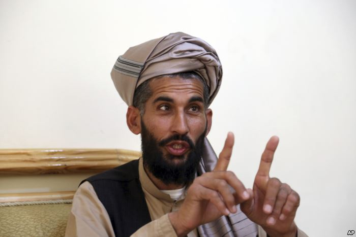 Masih Rahman speaks during an interview with the Associated Press in Kabul, A