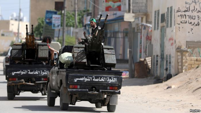 Members of Libyan internationally recognized pro-government forces ride in mi
