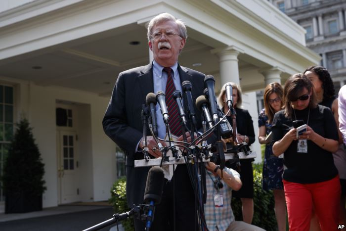 National security adviser John Bolton speaks with reporters outside the White