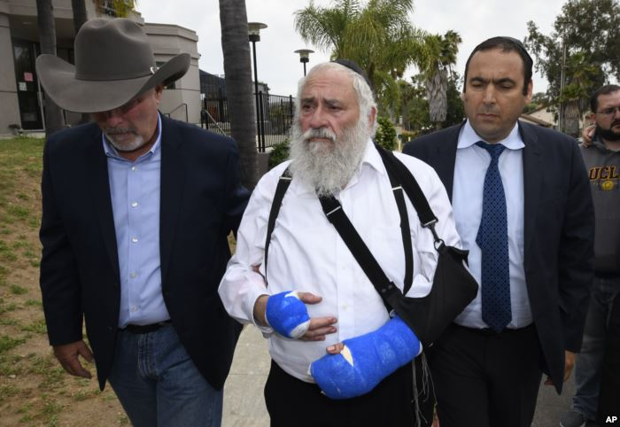Rabbi Yisroel Goldstein, center, arrives for a news conference at the Chabad