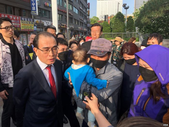 Thae Yong-Ho, a former North Korean diplomat, translates for the family of a