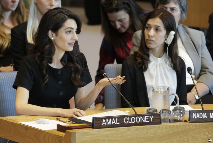 While Nadia Murad, right, listens, Amal Clooney speaks during a Security Coun