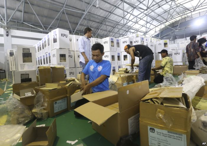 Workers prepare ballot boxes to be distributed to polling stations in Jakarta