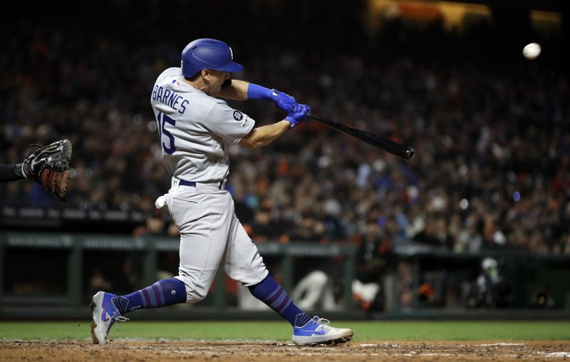 Los Angeles Dodgers' Austin Barnes swings for a two-run double off San Francisco Giants' Ty Blach during the sixth inning of a baseball game Tuesday, April 30, 2019, in San Francisco. (AP Photo/Ben Margot)