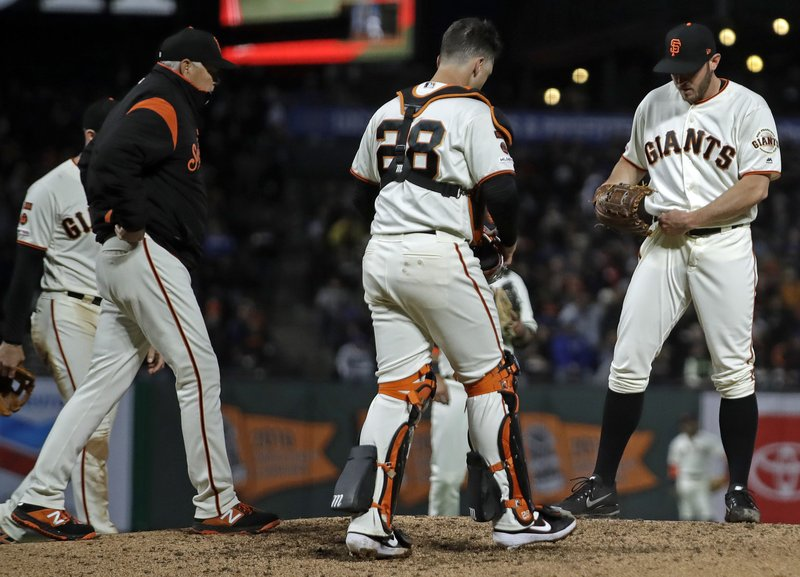 San Francisco Giants pitching coach Curt Young, left, walks on the mound to speak with pitcher Ty Blach, right, during the sixth inning of the team's baseball game against the Los Angeles Dodgers on Tuesday, April 30, 2019, in San Francisco. (AP Photo/Ben Margot)