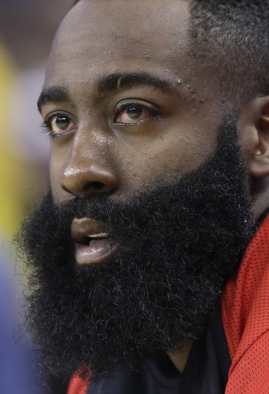 Houston Rockets' James Harden watches from the bench during the first half of Game 2 of the team's second-round NBA basketball playoff series against the Golden State Warriors in Oakland, Calif., Tuesday, April 30, 2019. (AP Photo/Jeff Chiu)