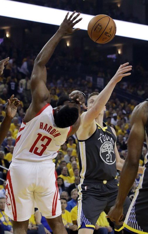 Houston Rockets' James Harden (13) drives to the basket as Golden State Warriors' Jonas Jerebko (21) defends during the first half of Game 2 of a second-round NBA basketball playoff series in Oakland, Calif., Tuesday, April 30, 2019. (AP Photo/Jeff Chiu)