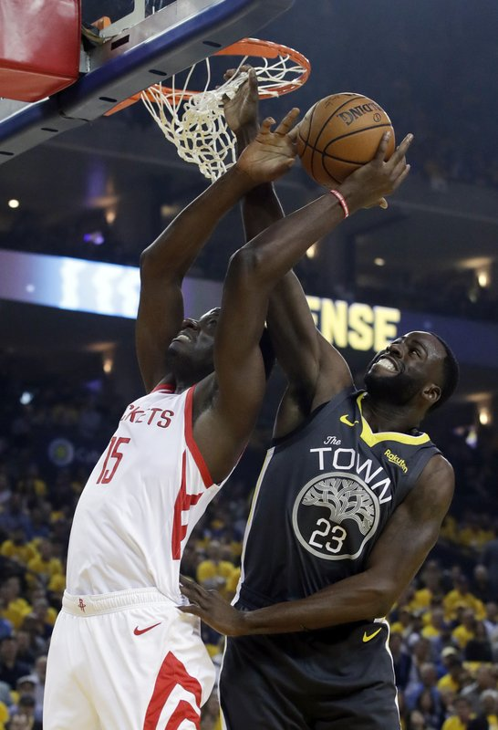Houston Rockets' Clint Capela, left, is defended by Golden State Warriors' Draymond Green during the first half of Game 2 of a second-round NBA basketball playoff series in Oakland, Calif., Tuesday, April 30, 2019. (AP Photo/Jeff Chiu)