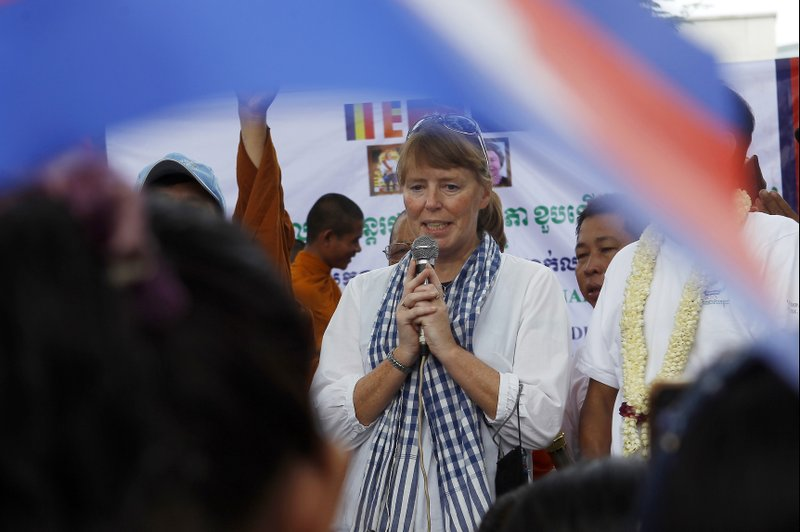 U.N. Special Rapporteur on Human Rights in Cambodia, Rhona Smith delivers a speech to mark May Day at Tonle Sap river bank in Phnom Penh, Cambodia, Wednesday, May 1, 2019. Some hundreds of workers staged a rally, demanding a better working condition. (AP Photo/Heng Sinith)
