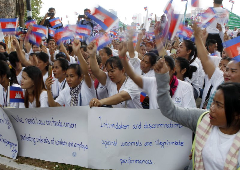 Cambodian workers gather to mark May Day at Tonle Sap river bank, in Phnom Penh, Cambodia, Wednesday, May 1, 2019. Some hundreds of workers staged a rally, demanding a better working condition. (AP Photo/Heng Sinith)