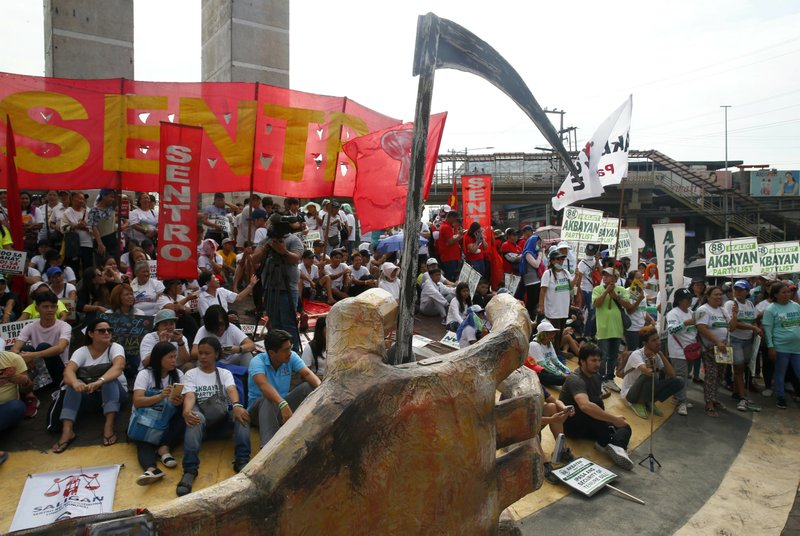 Protesters, mostly workers, gather for a rally prior to marching towards the Presidential Palace in Manila to pay tribute to workers in celebration of International Labor Day Wednesday, May 1, 2019 in the Philippines. (AP Photo/Bullit Marquez)