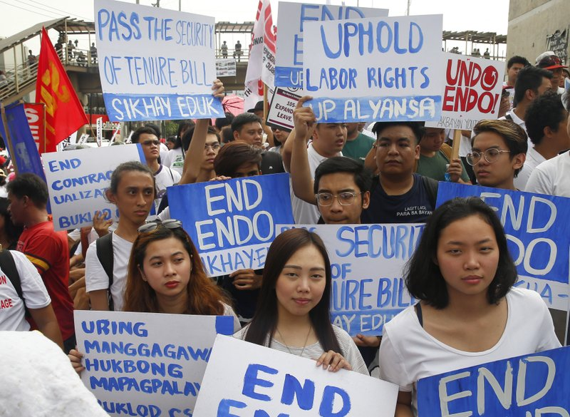 Protesters, mostly workers, gather for a rally prior to marching towards the Presidential Palace in Manila to pay tribute to workers in celebration of International Labor Day Wednesday, May 1, 2019 in the Philippines. The workers scored President Rodrigo Duterte allegedly for reneging in his campaign promise three years ago to end temporary hiring known as