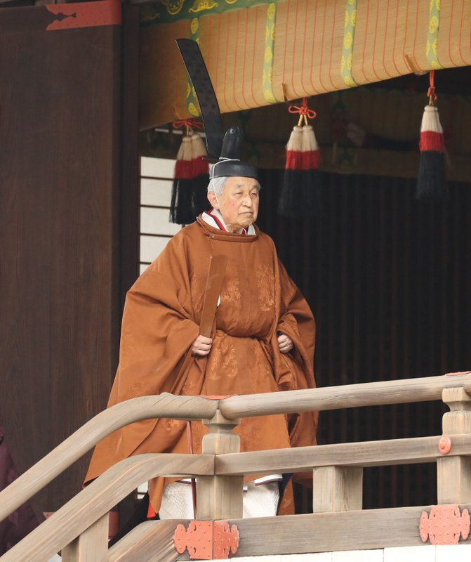 Japan's Emperor Akihito leaves after a ritual to report his abdication to the throne, at the Imperial Palace in Tokyo, Tuesday, April 30, 2019. Akihito announced his abdication at a palace ceremony Tuesday in his final address, as the nation embraced the end of his reign with reminiscence and hope for a new era. (Japan Pool via AP)