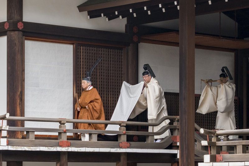 In this photo provided by the Imperial Household Agency of Japan, Japan's Emperor Akihito, left, walks for a ritual to report his abdication to the throne, at the Imperial Palace in Tokyo, Tuesday, April 30, 2019. The 85-year-old Akihito ends his three-decade reign on Tuesday when he abdicates to his son Crown Prince Naruhito. (The Imperial Household Agency of Japan via AP)
