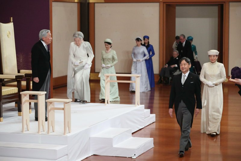 Japan's Emperor Akihito, left, with Empress Michiko, second from left, and his son Crown Prince Naruhito, second from right, and Crown Princess Masako, right, arrives for the ceremony of his abdication at the Imperial Palace in Tokyo, Tuesday, April 30, 2019. Akihito announced his abdication at a palace ceremony Tuesday in his final address, as the nation embraced the end of his reign with reminiscence and hope for a new era. (Japan Pool via AP)