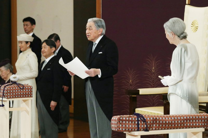 Japan's Emperor Akihito speaks during the ceremony of his abdication in front of other members of the royal families and top government officials at the Imperial Palace in Tokyo, Tuesday, April 30, 2019. The 85-year-old Akihito ends his three-decade reign on Tuesday as his son Crown Prince Naruhito, second from left, will ascend the Chrysanthemum throne on Wednesday. Empress Michiko is at right and Crown Princess Masako is at left. (Japan Pool via AP)