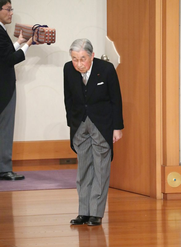 Japan's Emperor Akihito bows before leaving after the ceremony of his abdication in front of other members of the royal families and top government officials at the Imperial Palace in Tokyo, Tuesday, April 30, 2019. The 85-year-old Akihito ends his three-decade reign on Tuesday as his son Crown Prince Naruhito will ascend the Chrysanthemum throne on Wednesday. (Japan Pool via AP)