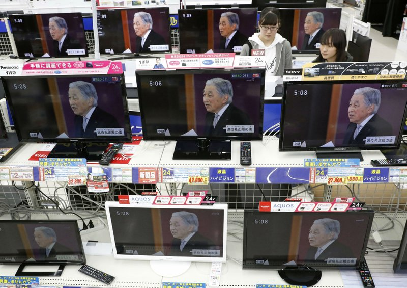 TV screens show news program reporting on Emperor Akihito's abdication, at an electrical appliance store in Urayasu, near Tokyo Tuesday, April 30, 2019. Akihito announced at a ceremony that he is abdicating, in his final official address to his people. (Yukie Nishizawa/Kyodo News via AP)