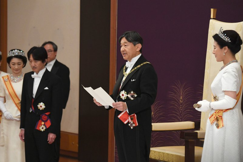Japan's new Emperor Naruhito, accompanied by new Empress Masako, makes his first address during a ritual after succeeding his fatherAkihito at Imperial Palace in Tokyo, Wednesday, May 1, 2019. Crown Prince and Crown Princess Akishino are seen at left. (Japan Pool via AP)