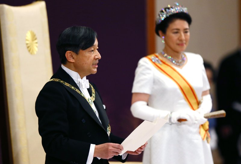 Japan's new Emperor Naruhito, accompanied by new Empress Masako, makes his first address during a ritual after succeeding his fatherAkihito at Imperial Palace in Tokyo, Wednesday, May 1, 2019. (Japan Pool via AP)