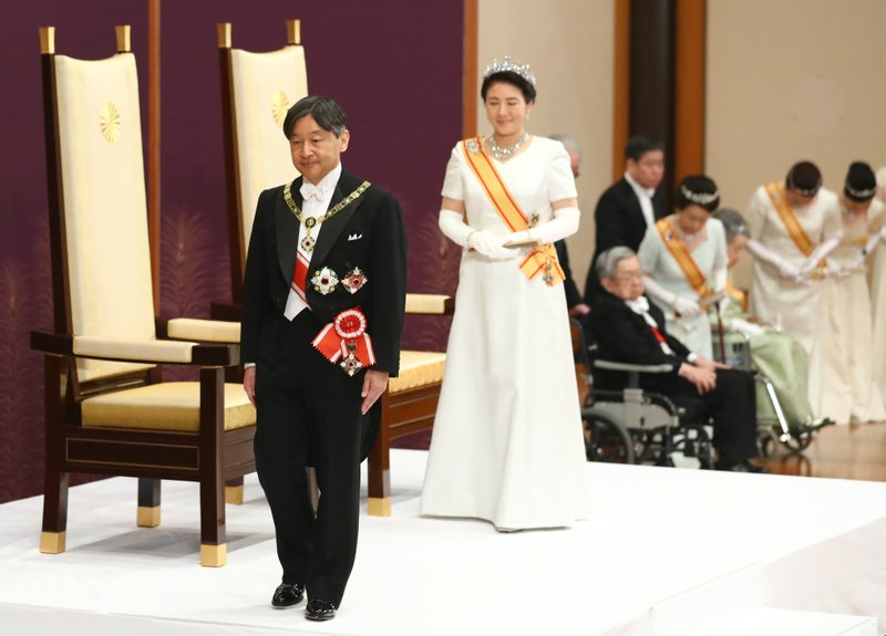 Japan's new Emperor Naruhito, accompanied by new Empress Masako, leaves after making his first address during a ritual after succeeding his fatherAkihito at Imperial Palace in Tokyo, Wednesday, May 1, 2019. (Japan Pool via AP)