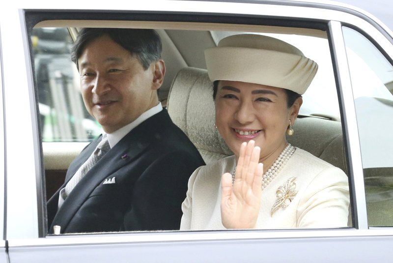 Japan's new Emperor Naruhito and new Empress Masako are driven to Imperial Palace to greet Emperor Emeritus Akihito and Empress Emerita Michiko in Tokyo, Wednesday, May 1, 2019. Naruhito succeeded to the Chrysanthemum Throne Wednesday after his father Akihito abdicated Tuesday. (AP Photo/Koji Sasahara)