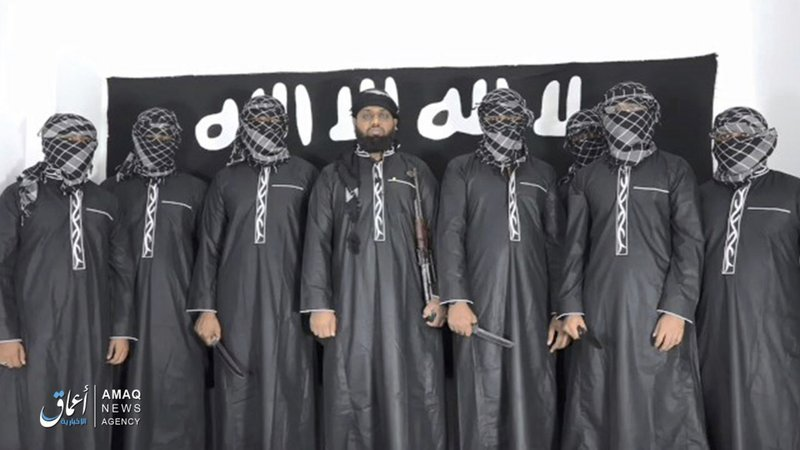 FILE -  This undated file image posted by the Islamic State group's Aamaq news agency on Tuesday, April 23, 2019, purports to show Mohammed Zahran, a.k.a. Zahran Hashmi, center, the man Sri Lanka says led the Easter attack that killed over 300 people, as well as other attackers. Sri Lankan authorities have blamed the militant Muslim group National Thowfeek Jamaath for the attack. The Islamic State group released the photo Tuesday to assert its claim on the assault. (Aamaq news agency via AP, File)