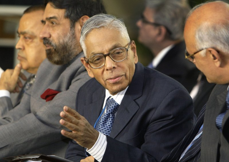"""FILE- A Dec. 5, 2008 file photo of India's National Security Advisor M.K. Narayanan. Indian and Bangladeshi officials and security experts largely dismissed a fresh threat of violence from an Islamic State-aligned media group, insisting that routine monitoring of would-be militants would prevent a Sri Lanka-style attack from taking place elsewhere in South Asia. Al-Mursalat Media released a graphic on Tuesday of five militants who carried out a 2016 attack at a cafe in the diplomatic enclave of Bangladesh's capital, Dhaka, according to global terrorism monitor SITE Intelligence. Narayanan said that while he """"wouldn't read this as a harbinger of what they're about to do,"""" President Donald Trump """"is off the mark when he says that IS is dead."""".(AP Photo/Gurinder Osan, File)"""