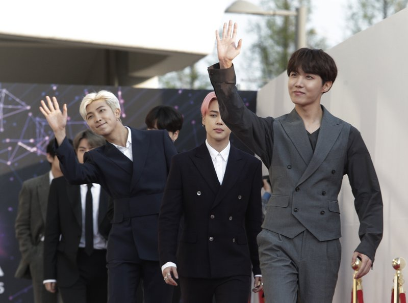 Members of South Korean K-Pop group BTS arrive to attend The Fact Music Awards in Incheon, South Korea, Wednesday, April 24, 2019. (AP Photo/Ahn Young-joon)
