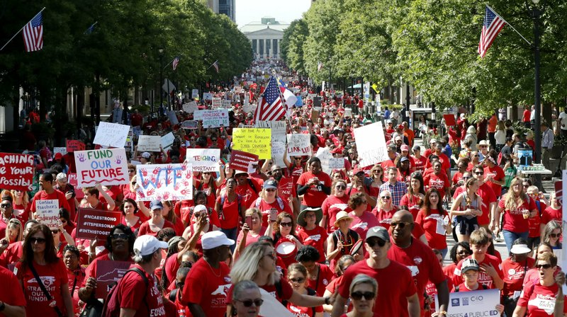 Thousands of teachers, other school employees and their supporters marched up Fayetteville Street through downtown Raleigh, N.C. Wednesday, May 1, 2019. North Carolina teachers took to the streets Wednesday for the second year in a row with hopes that a more politically balanced legislature will be more willing to meet their demands. (Ethan Hyman/The News & Observer via AP)