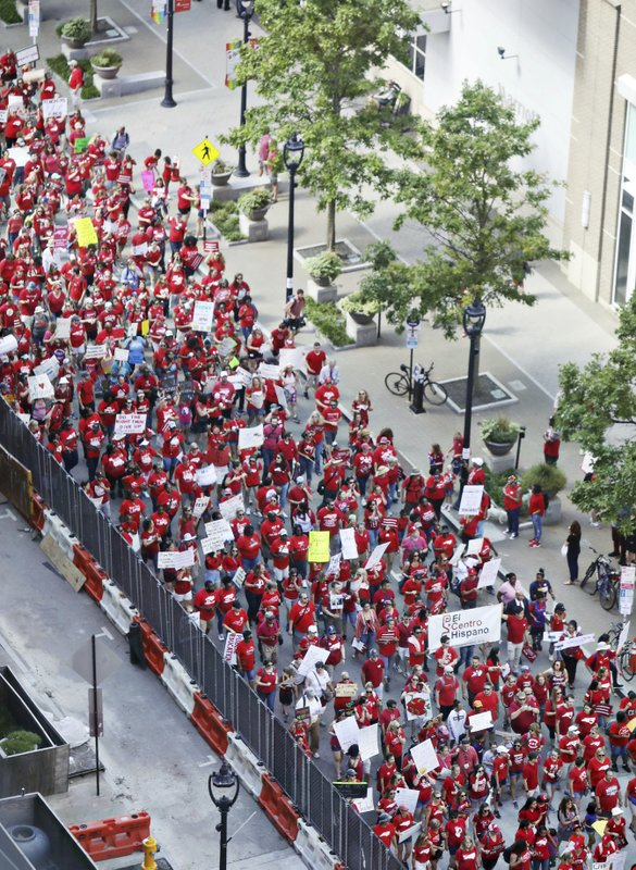 Teachers and supporters head down Fayetteville Street in downtown Raleigh, N.C., at the start of the teacher's march Wednesday morning, May 1, 2019. North Carolina teachers took to the streets Wednesday for the second year in a row with hopes that a more politically balanced legislature will be more willing to meet their demands. (Juli Leonard/The News & Observer via AP)