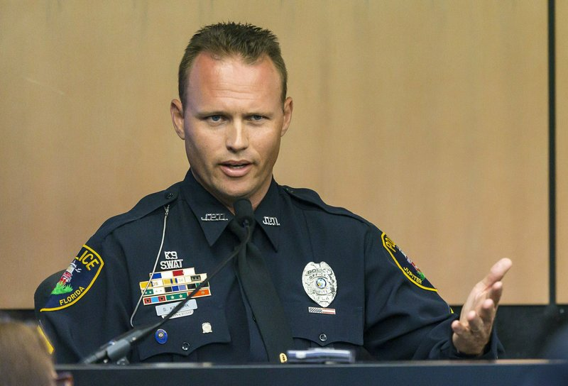 Jupiter police officer Scott Kimbark testifies during a motion hearing in New England Patriots owner Robert Kraft prostitution solicitation case, Wednesday, May 1, 2019, in West Palm Beach, Fla. Kimbark stopped the car containing Kraft. Kraft's attorneys argue that undercover surveillance videos allegedly showing their client paying for sex at a Jupiter day spa should be ruled inadmissible and the evidence thrown out. (Lannis Waters/Palm Beach Post via AP, Pool)