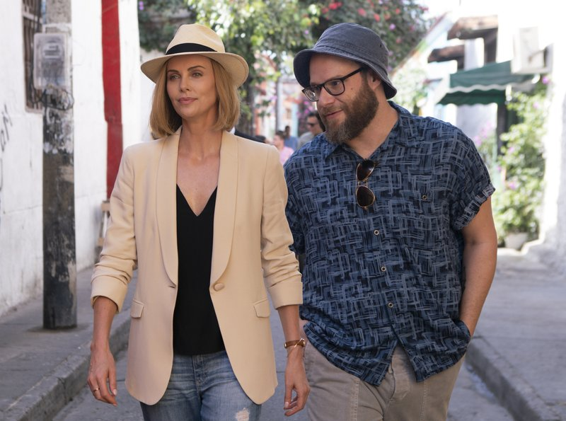 This image released by Lionsgate shows Charlize Theron, left, and Seth Rogen in a scene from