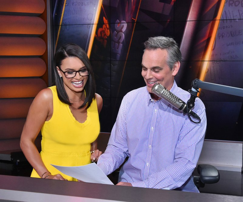 This photo provided by Fox Sports shows Joy Taylor and Colin Cowherd at Fox Sports Studios in Los Angeles. Fox Sports 1 has built its fortunes around Colin Cowherd and Skip Bayless, but it has also surrounded them with other shows that give the network at least 12 hours of studio programming a day.  (Fox Sports via AP)
