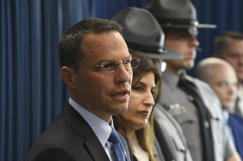 Pennsylvania's attorney general, Josh Shapiro, speaks at a news conference in his office headquarters, Wednesday, May 1, 2019 in Harrisburg, Pa. Shapiro announced that a Pennsylvania doctor, Dr. William Vollmar, already charged with sexually assaulting a man during an office visit faces new allegations he sexually assaulted four other patients, including a student. (AP Photo/Marc Levy)