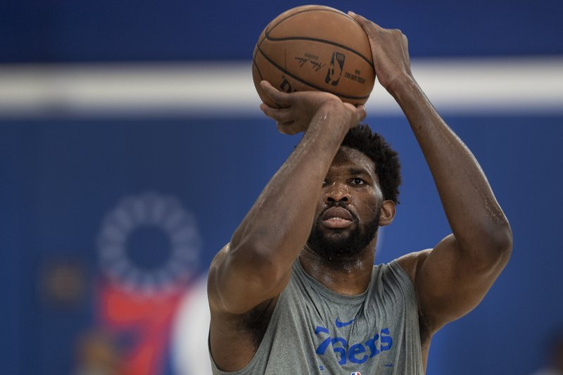 Philadelphia 76ers NBA basketball player Joel Embiid shoots during practice at the 76ers practice complex in Camden, N.J., Wednesday, May 1, 2019. Game 3 of the Eastern Conference semifinals between the 76ers and Toronto Raptors is Thursday in Philadelphia. (Jose F. Moreno/The Philadelphia Inquirer via AP)