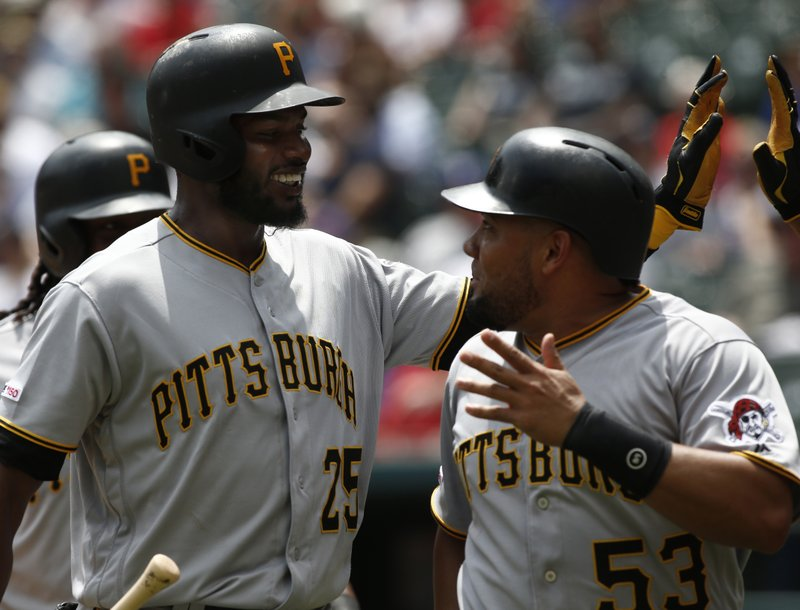 Pittsburgh Pirates' Gregory Polanco (25) celebrates with Melky Cabrera (53) after they both scored on a hit by Bryan Reynolds against the Texas Rangers during the fourth inning of a baseball game Wednesday May 1, 2019, in Arlington, Texas. (AP Photo/Mike Stone)