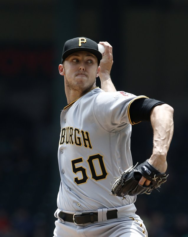 Pittsburgh Pirates starting pitcher Jameson Taillon delivers against the Texas Rangers during the first inning of a baseball game Wednesday May 1, 2019, in Arlington, Texas. (AP Photo/Mike Stone)